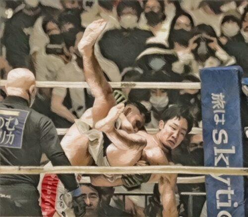 コーナーを背負ってテイクダウンを取られる朝倉選手